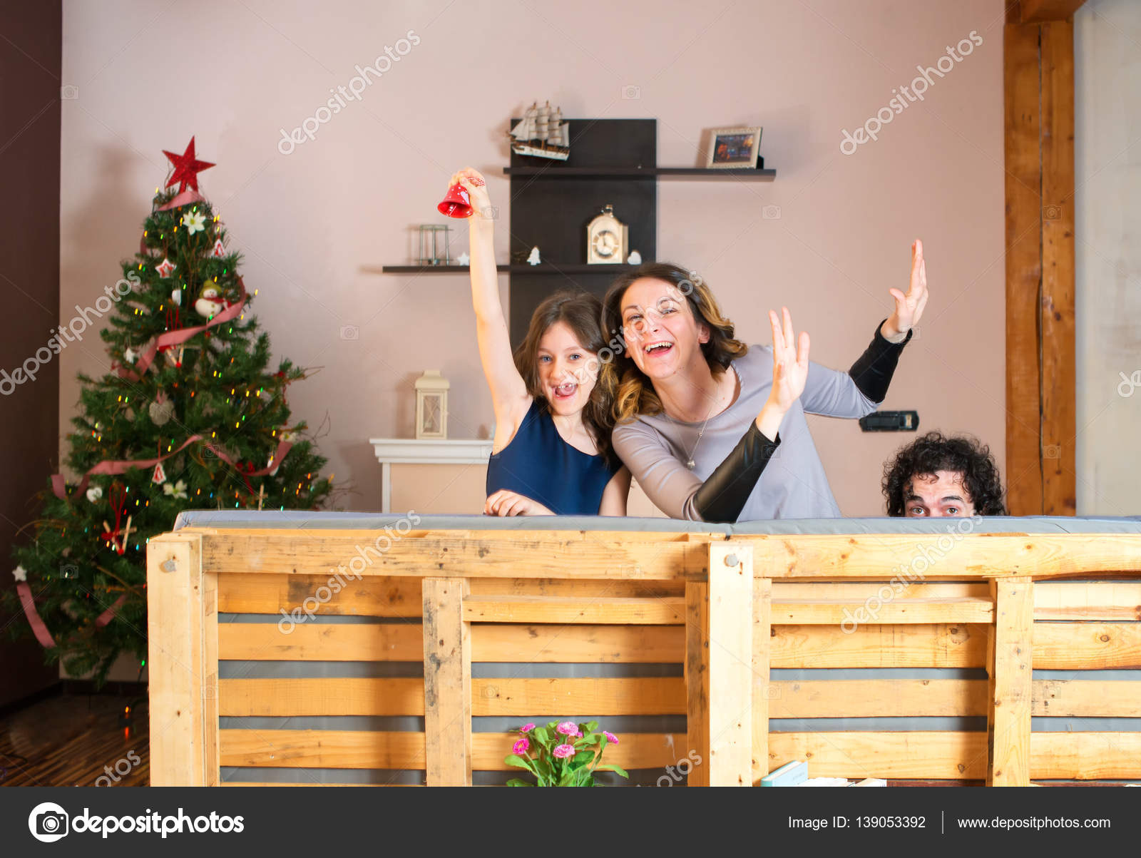mother and daughter happy beacause of holidays and father is hiding