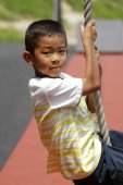 Fotografie Japanese boy playing with flying fox (second grade at elementary school)
