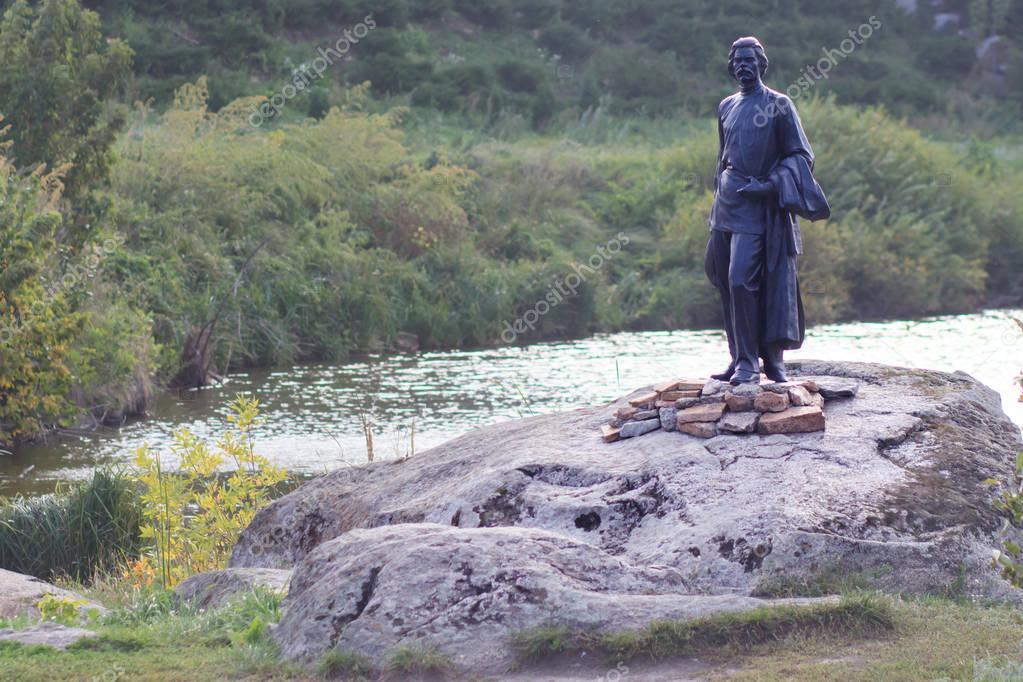 Monument to the Communist Soviet poet Maxim Gorky on the shore of a lake in the village Buki. Kiev region. Ukraine.