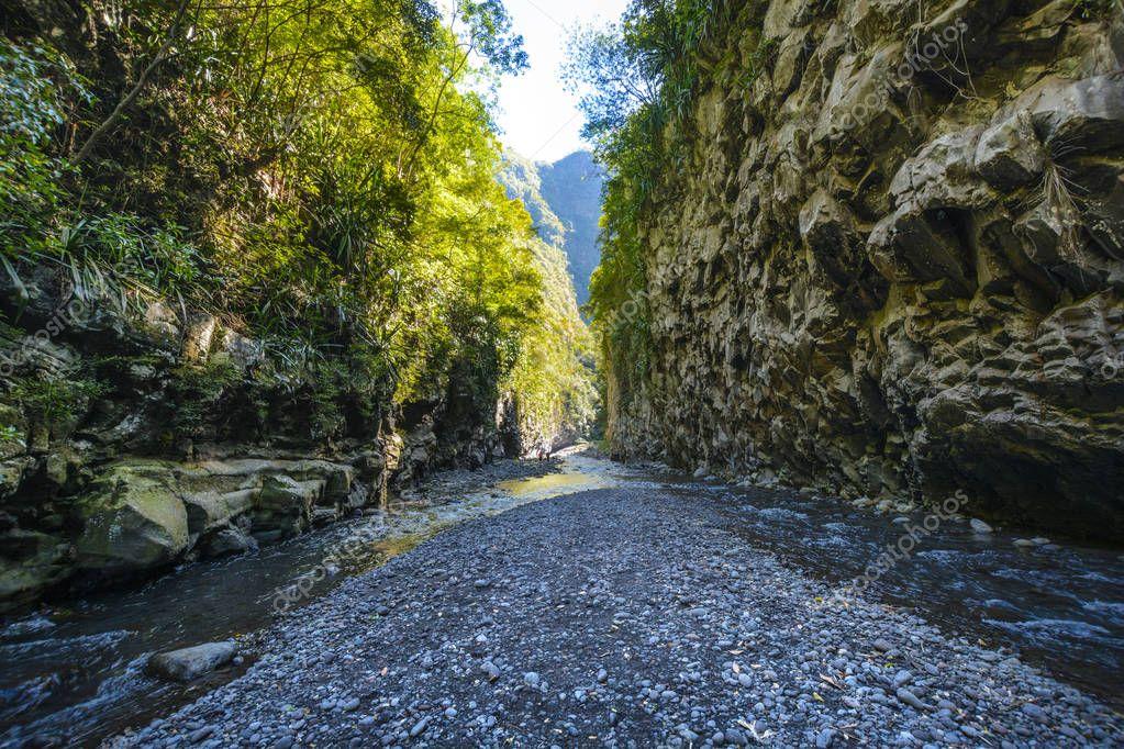 Hiking in a canyon of Bras de La Plain at Reunion Island