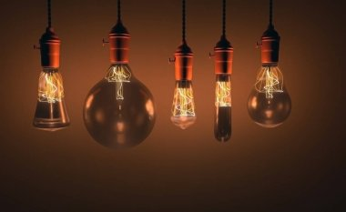 Decorative antique edison style light bulbs against wall background