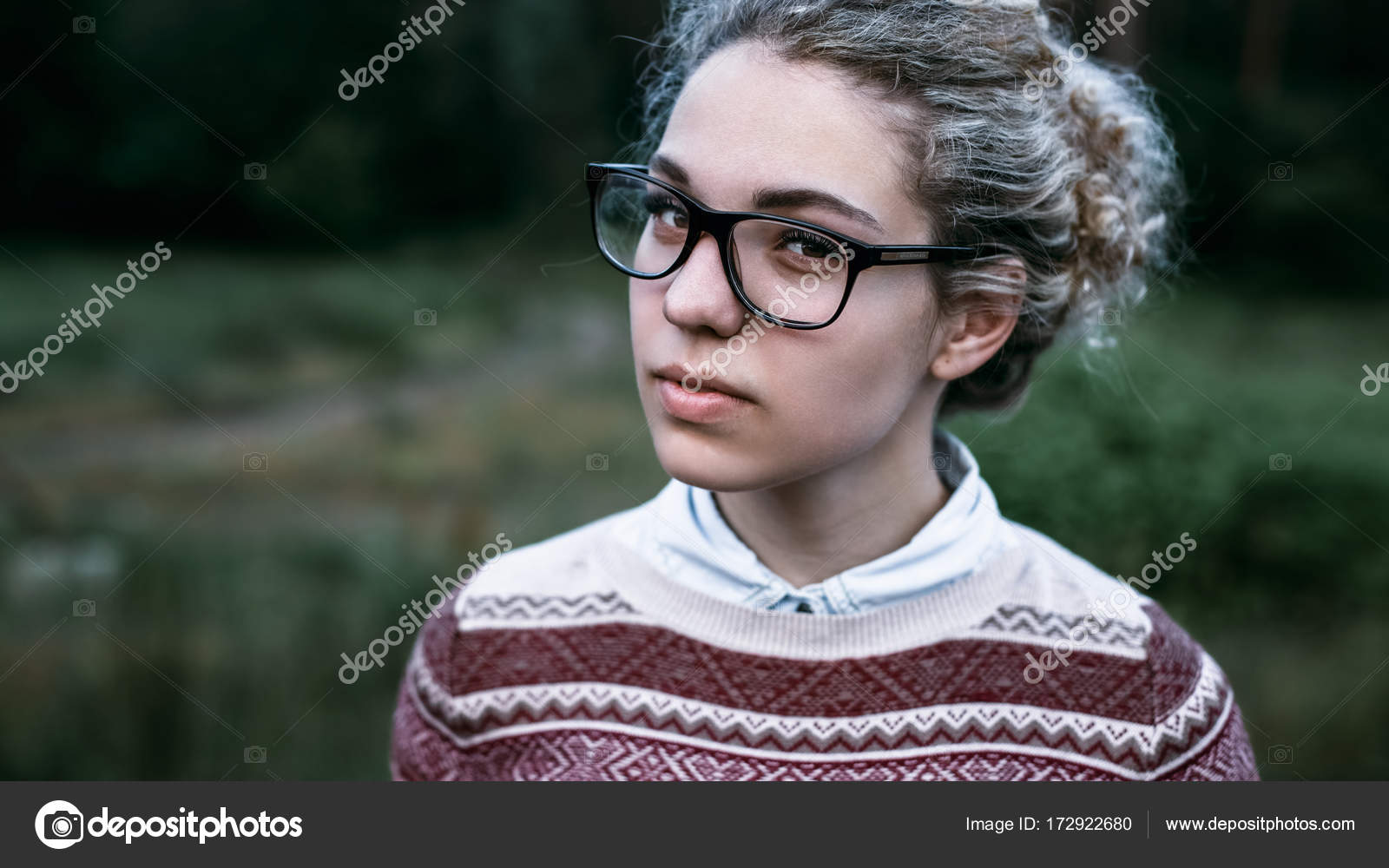 Cute Girl Blonde With Curly Hair Brown Eyes Wearing A Sweater