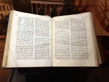 Williamstown, KY, USA - November 3, 2017:  Syriac New Testament from 1826 which mentions Paul's journeys in Syria in Syriac displayed in Noah's ark replica at the Ark Encounter Theme Park in Williamstown, Kentucky, USA