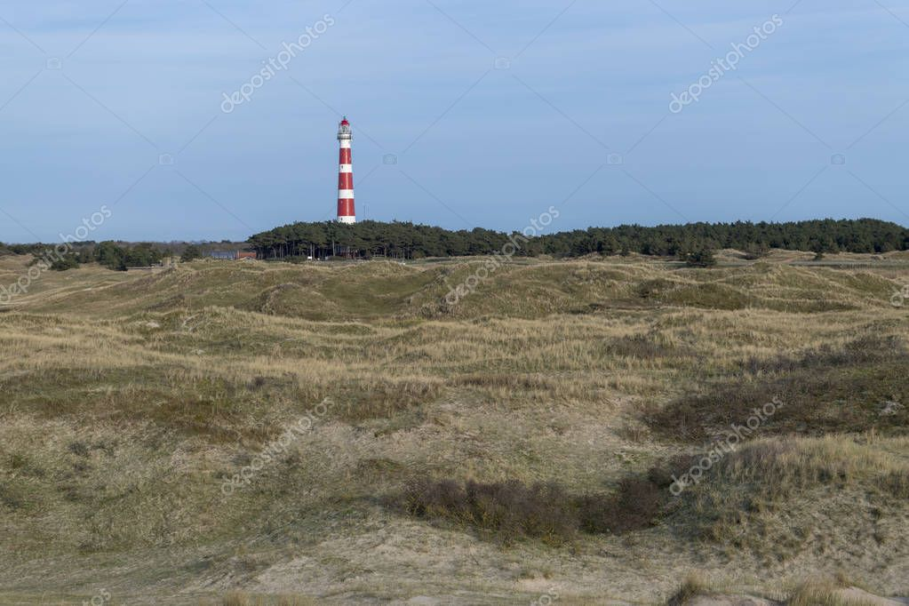 Lighthouse of the Dutch island Ameland with dunes