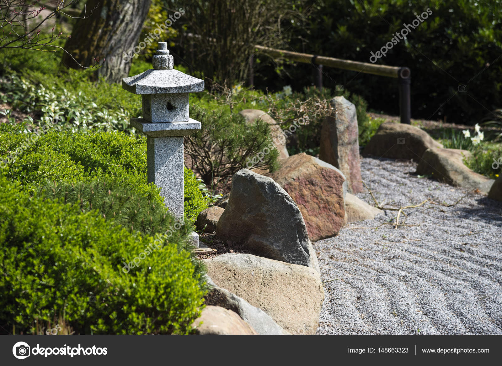 Stone lantern between evergreen plants, rocks and raked ... on shade garden landscape design, secret garden landscape design, zen garden photography, zen garden fountains, zen garden maintenance, cottage garden landscape design, zen garden waterfalls, vegetable garden landscape design, zen garden hardscape, flower garden landscape design, english garden landscape design, spanish garden landscape design, butterfly garden landscape design, zen garden fencing, roof garden landscape design, rock garden landscape design, zen garden sculpture, meditation garden landscape design, kitchen garden landscape design, rose garden landscape design,