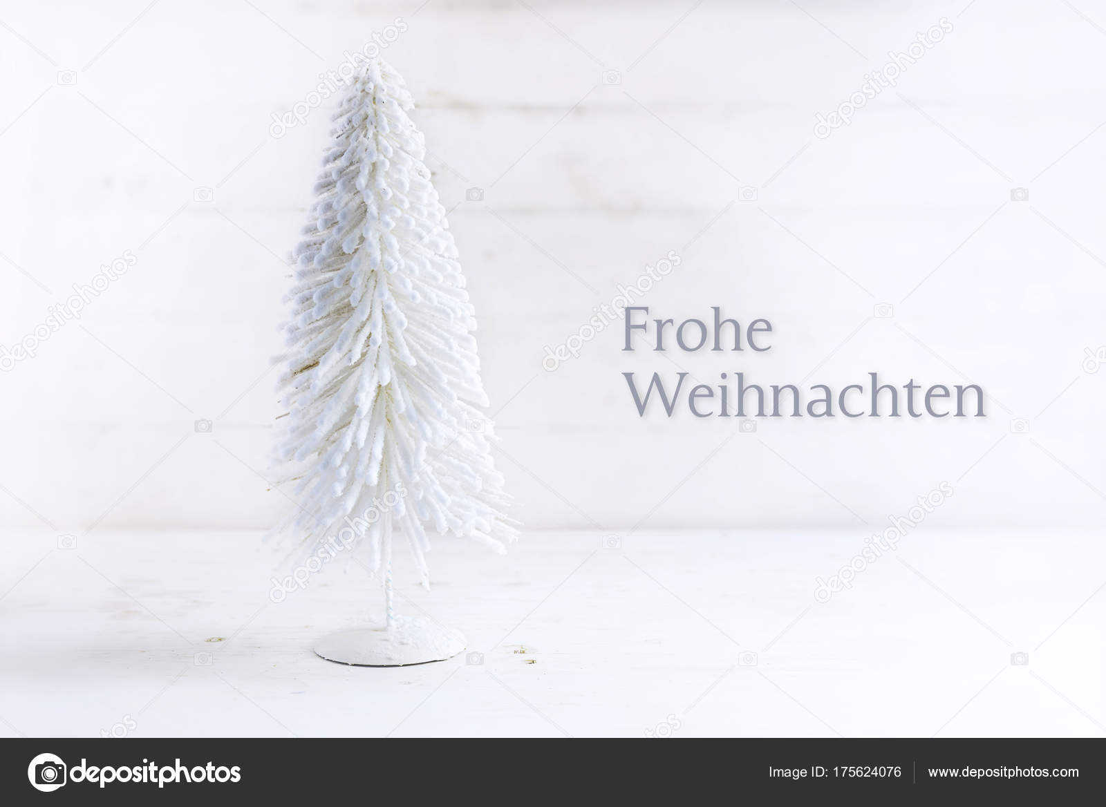 white christmas tree made of flocked wire on rustic white painted ...