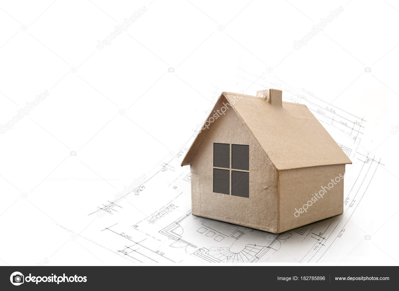 Model House Made Of Cardboard On An Architecture Plan
