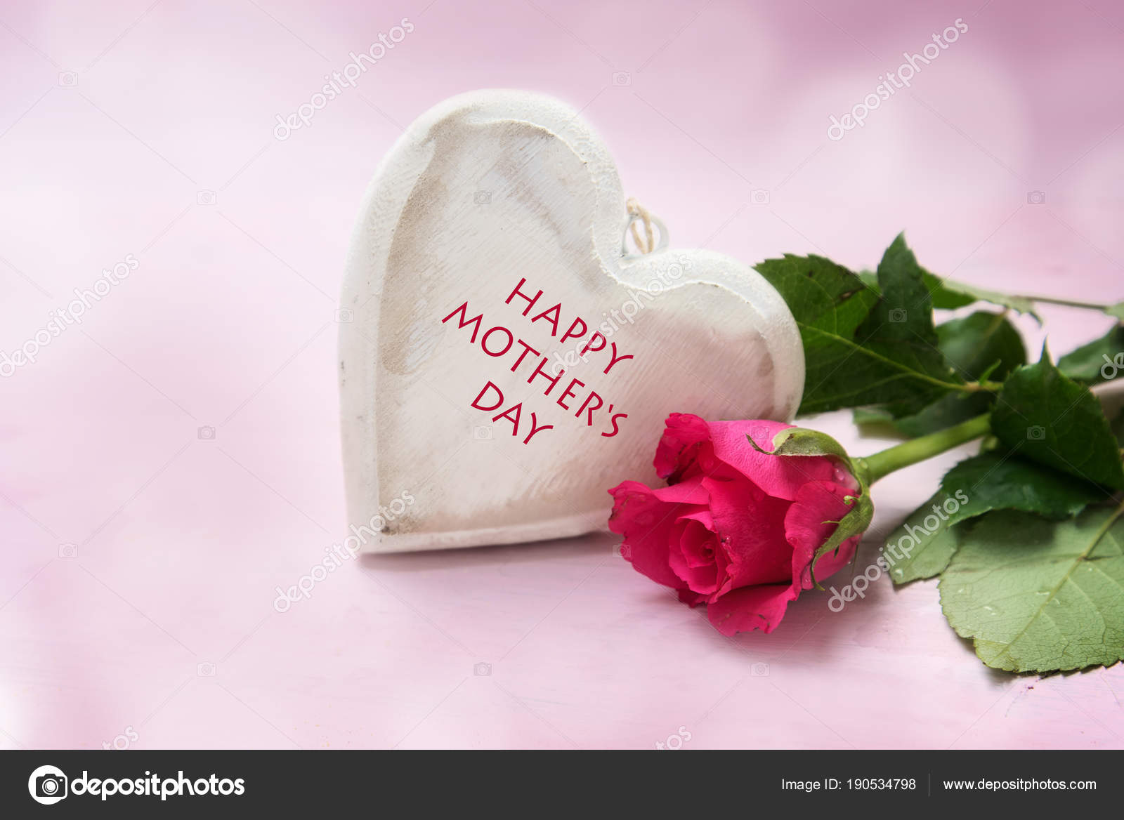 heart of wood and a rose on a pink background, text Happy Mother\'s ...