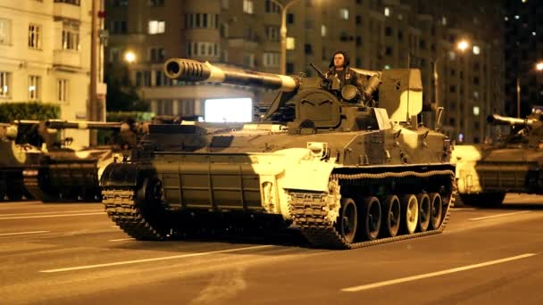 Belarus Minsk parade July 4, 2014 army soldier night city street avenue  parade military equipment agricultural machinery harvester tractor tank  rocket launcher rocketeer tanker helmet military army