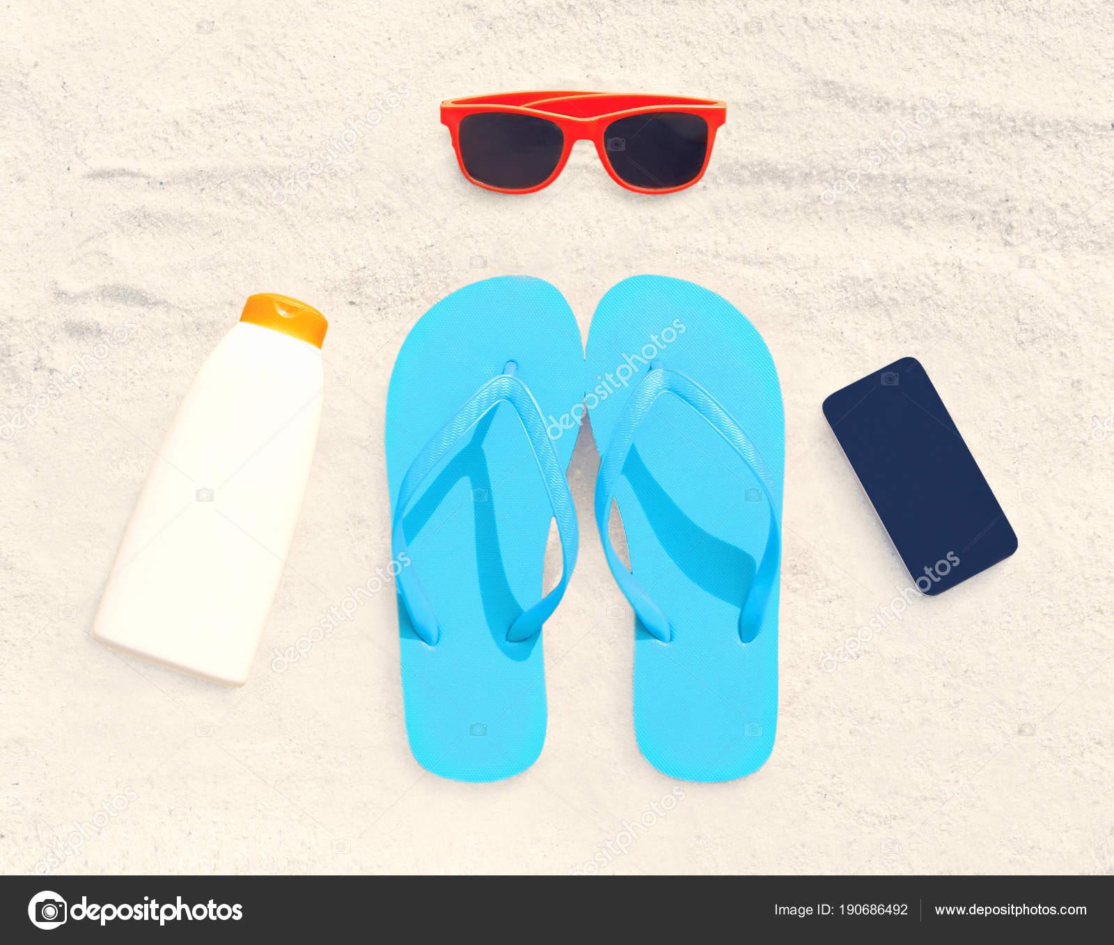 teléfono inteligente sin marco, botella de protector solar, gafas de ...