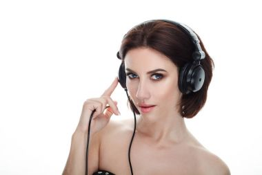 Beauty portrait of adult adorable fresh looking brunette woman with gorgeous makeup dj headphones bob hairdo posing against isolated white background showing emotion and facial expression concept.