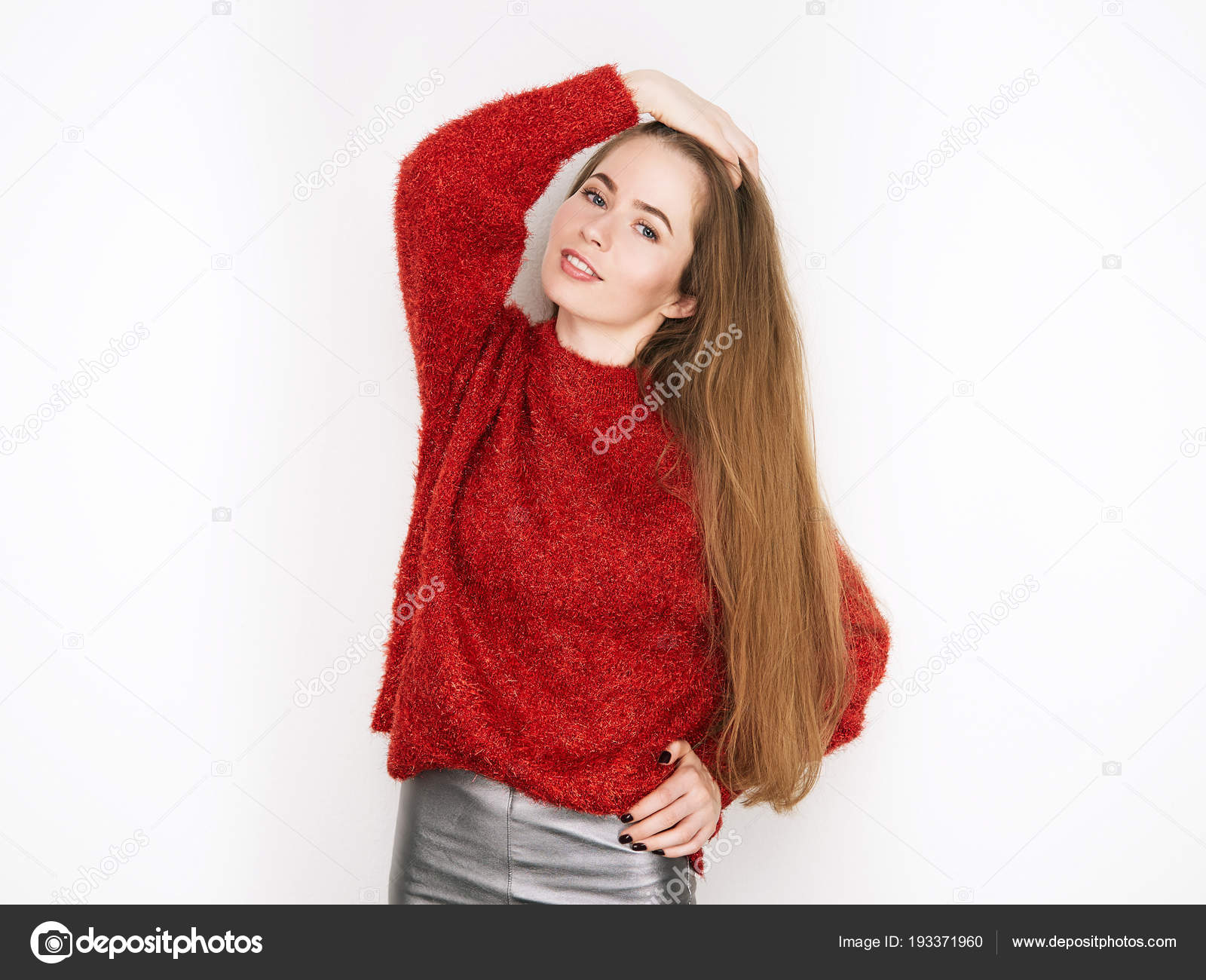 Spectacular Blonde Woman In Red Blouse Silver Leather Pants Posing