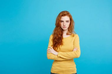 Portrait of young beautiful ginger woman with tender serious fac
