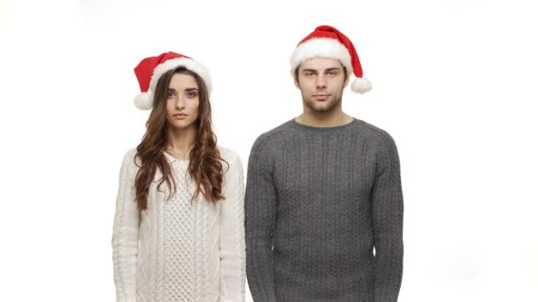 4k Young couple in sweaters showing present and show shocking expression to camera.
