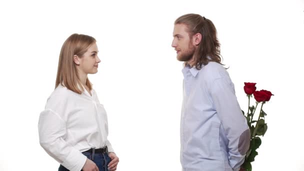 Man gives roses to a woman over white background.