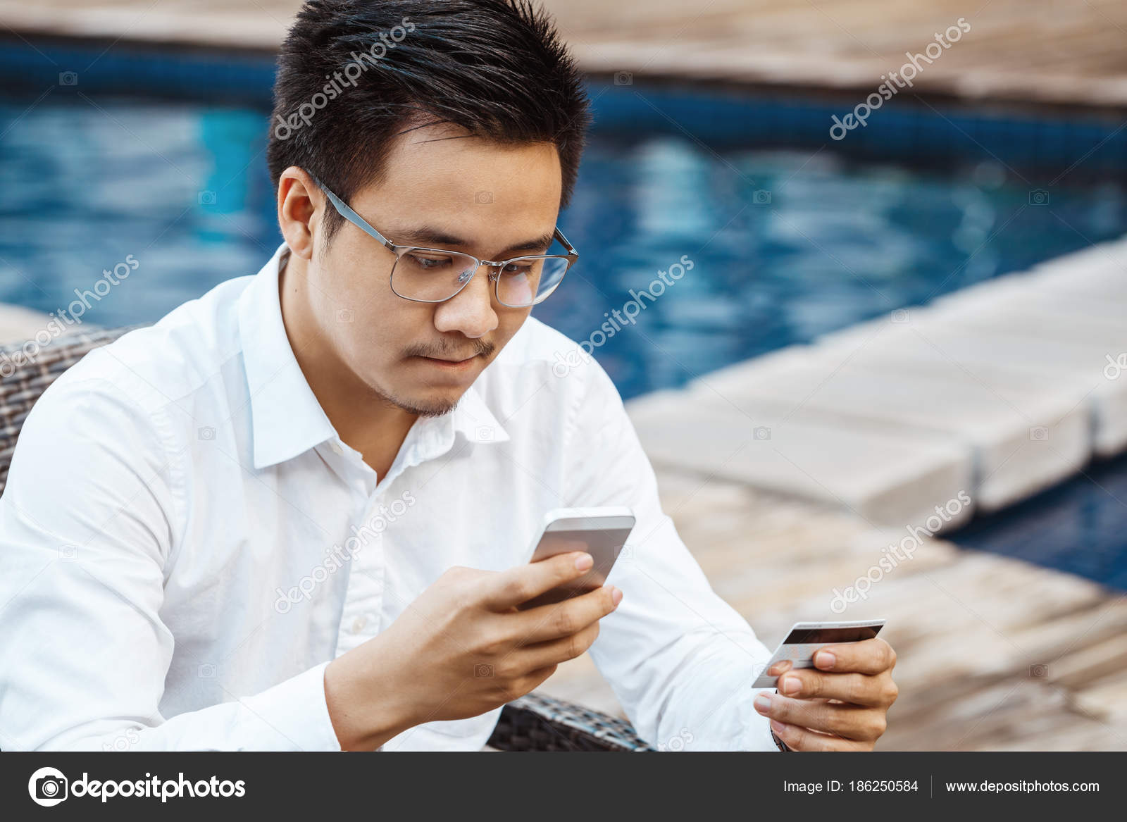 9a36bfd2872 Young Handsome man enjoy shopping online on mobile phone with credit card —  Stock Photo