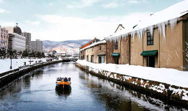 View of Otaru Canel in Winter season with signature tourist boat, Hokkaido - Japan