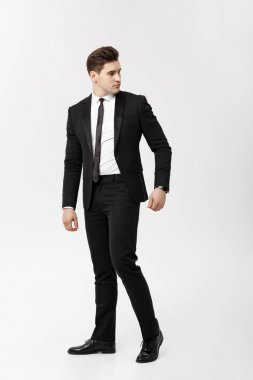 Full length Portrait Businessman posing stylishly on white background.