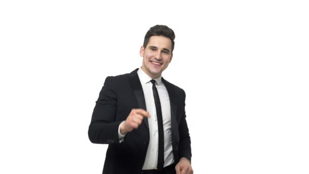 Slow-motion happy businessman dancing in smart suit isolated over white grey background.