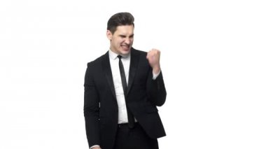 Slow motion Handsome young businessman doing victory gesture about successful achievement. Isolated over white grey background.