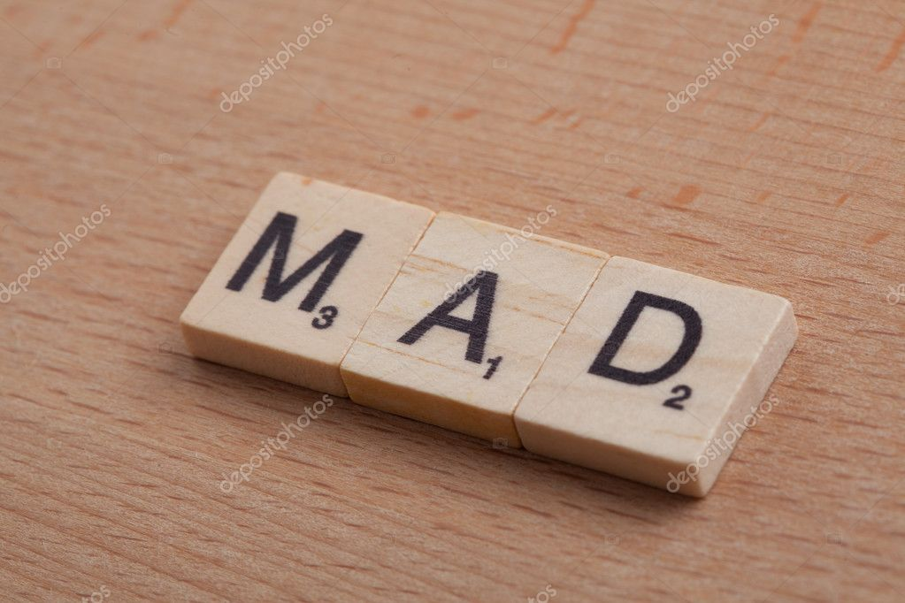 scrabble letters spelling the word mad stock photo