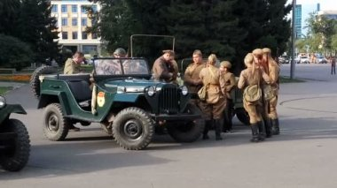 Krasnoyarsk, Russia - September 03, 2016: exhibition of a retro of cars, people are dressed in a military uniform of war 1941-1945. Editorial Use Only