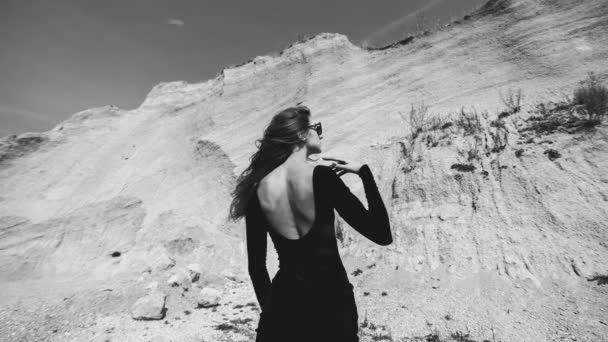Pretty woman in long black dress