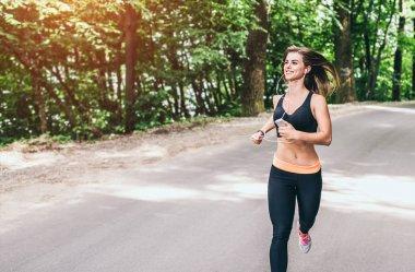 Fitness girl running in park
