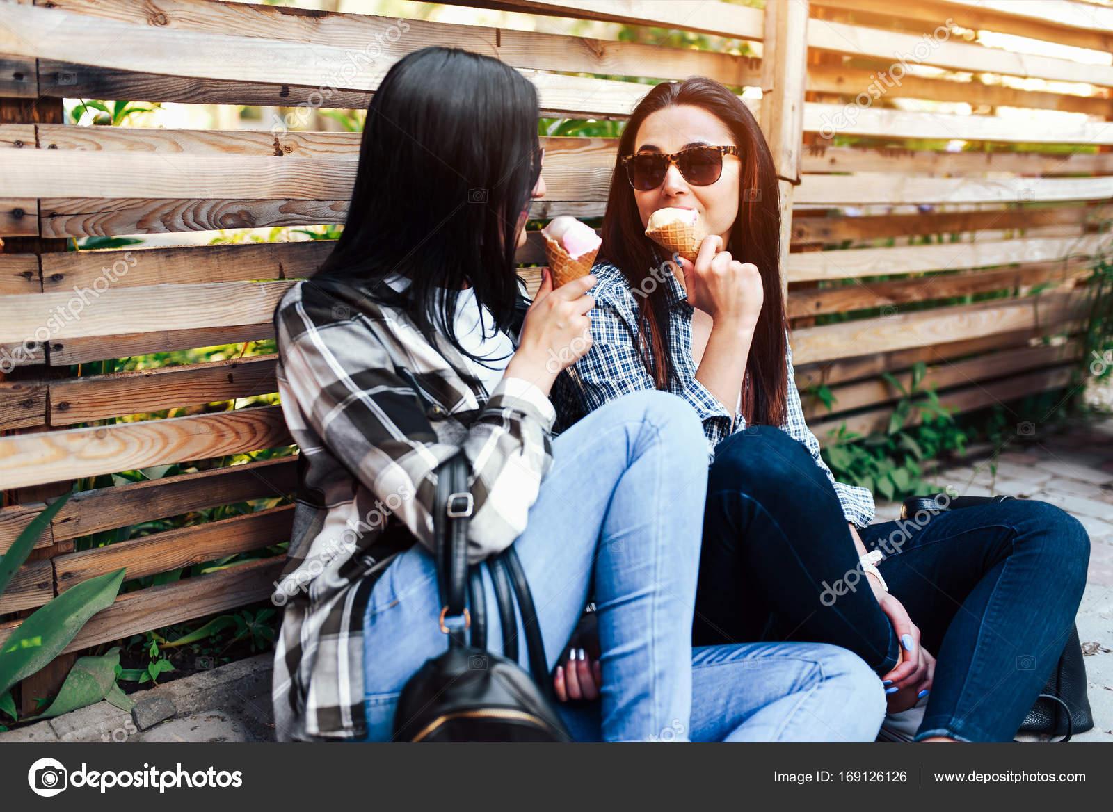 Two Girls Eating Ice Cream Stock Photo