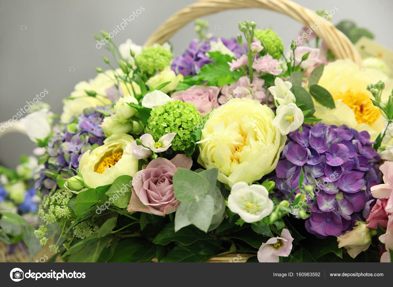 Basket with beautiful flowers stock photo ozina 160983592 basket with beautiful flowers photo by ozina izmirmasajfo