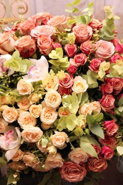 Huge bouquet of roses with orchids