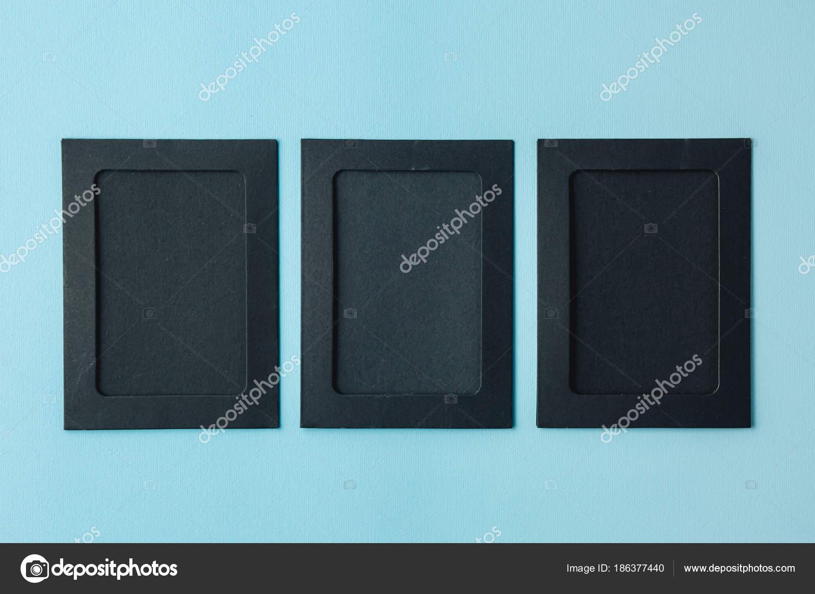 Marcos negro sobre un fondo azul — Fotos de Stock © alexxndr #186377440