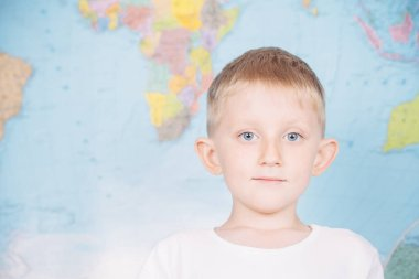 little boy on the background of a world map