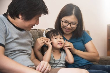 Happiness of Asian  family with young father, mother and little