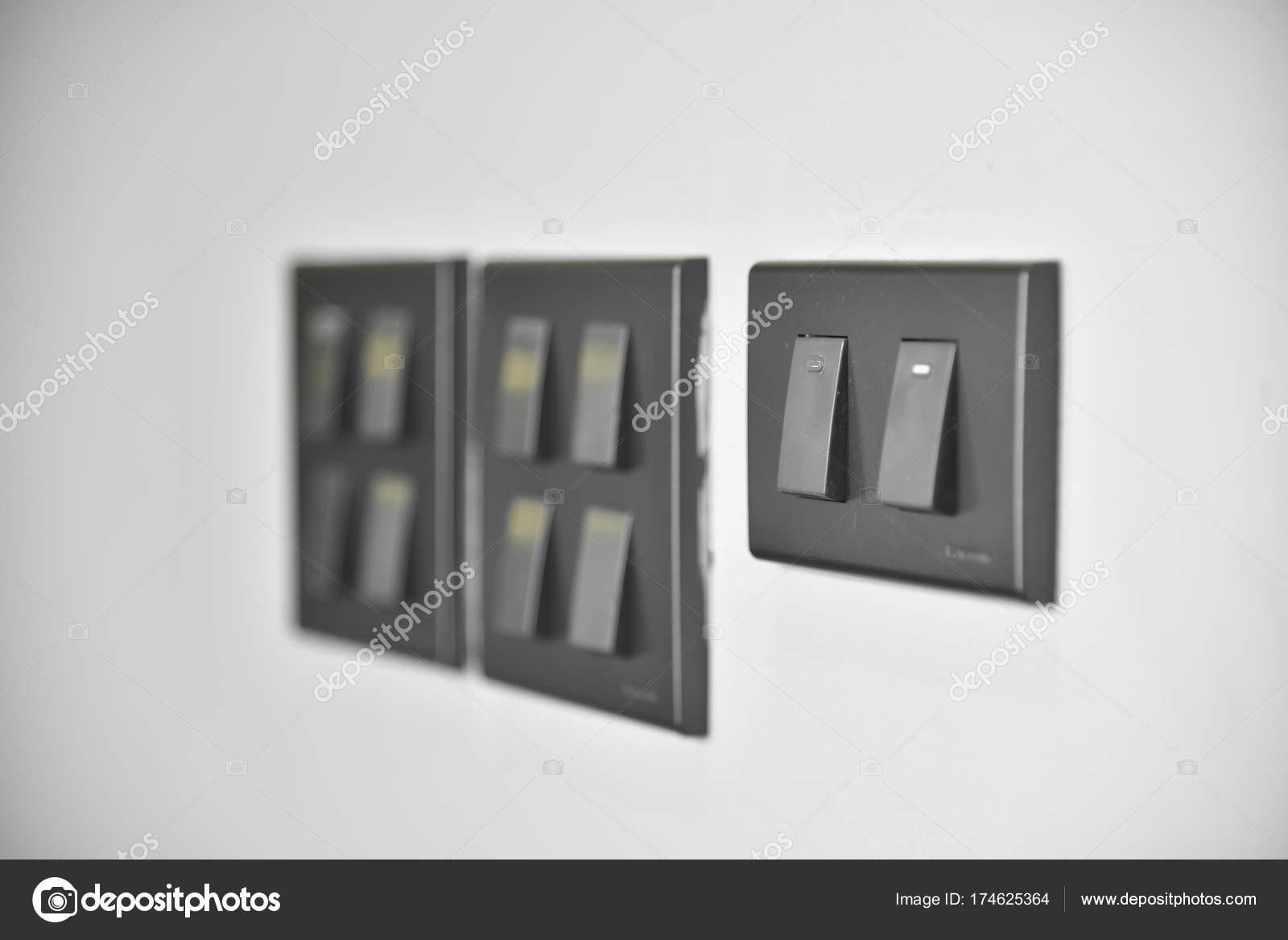 lighting switches on wall. — Stock Photo © eggeeggjiew #174625364