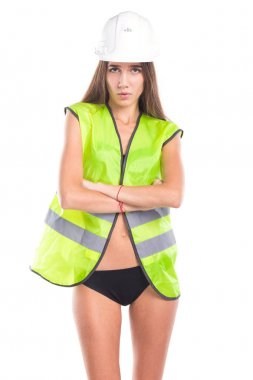 pretty brunette young woman in builder outfit and black bikini