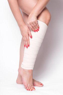 girl with elastic bandage on leg