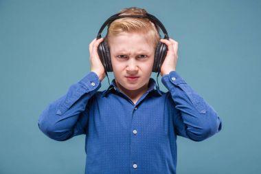 Blonde boy listening music