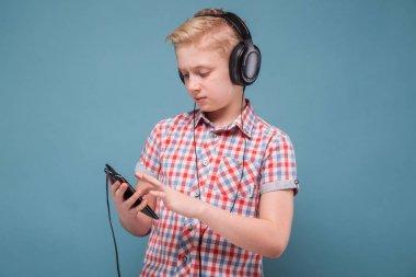 Blonde boy with black headphones