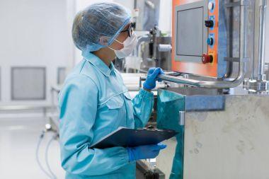 scientist standing near control panel