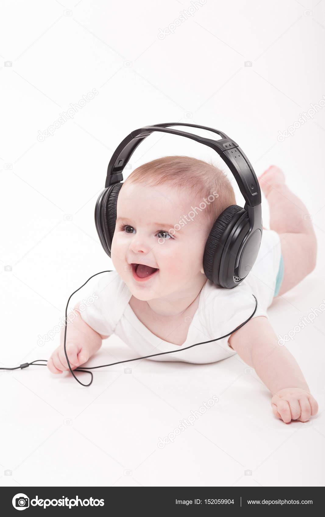 cute baby boy in headphones — stock photo © fotoevent.stock #152059904