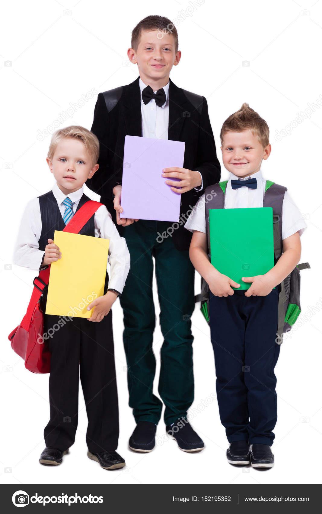 52e4bf00c18 Colegial mayor y dos niños con los libros — Foto de stock ...