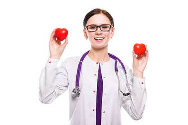 Young female doctor holding two red hearts stock vector