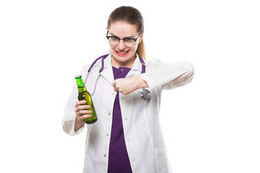 Young female doctor holding bottle of beer isolated on white background