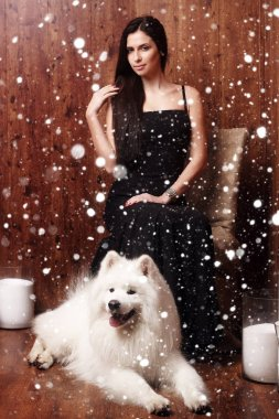 beautiful brunette young woman long black dress with a snow
