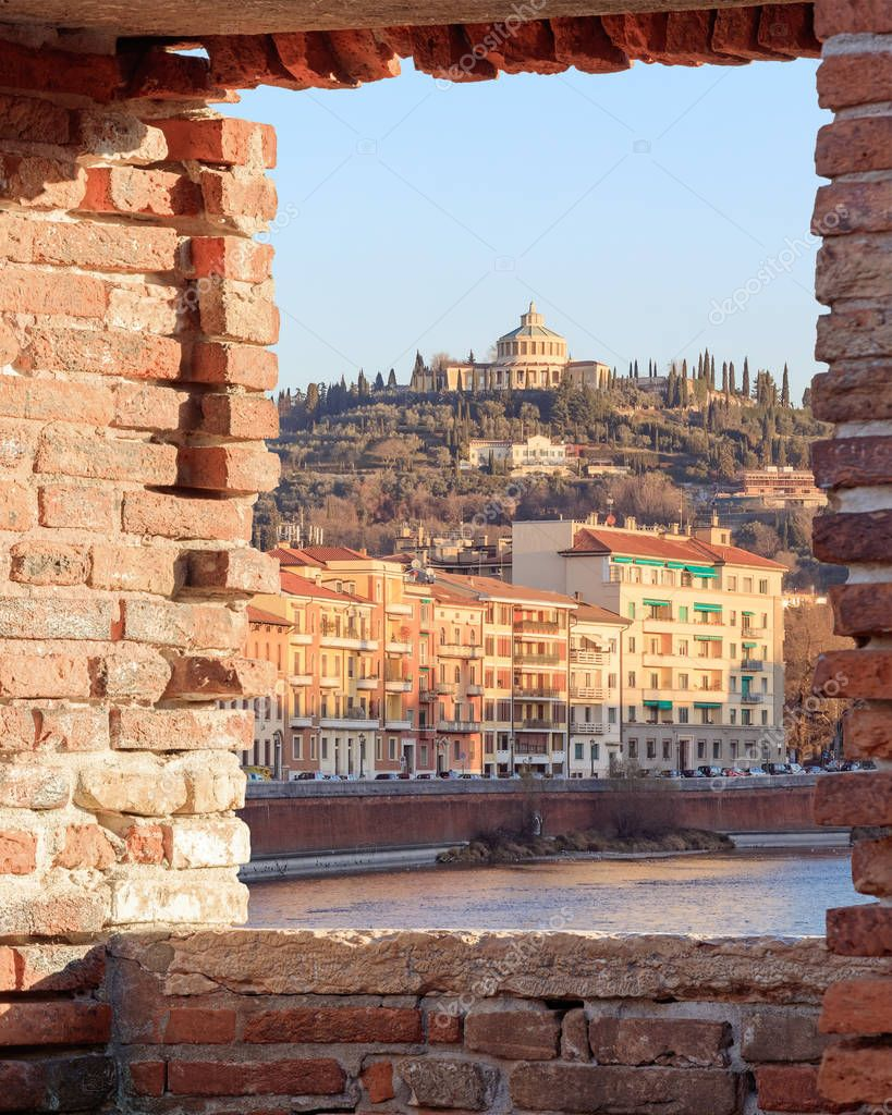 Old Verona town, view through brickwall window