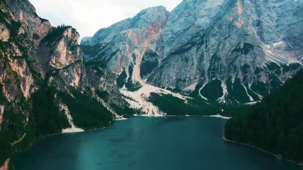 An aerial view over Braies Lake, Dolmites mountain, water reflections