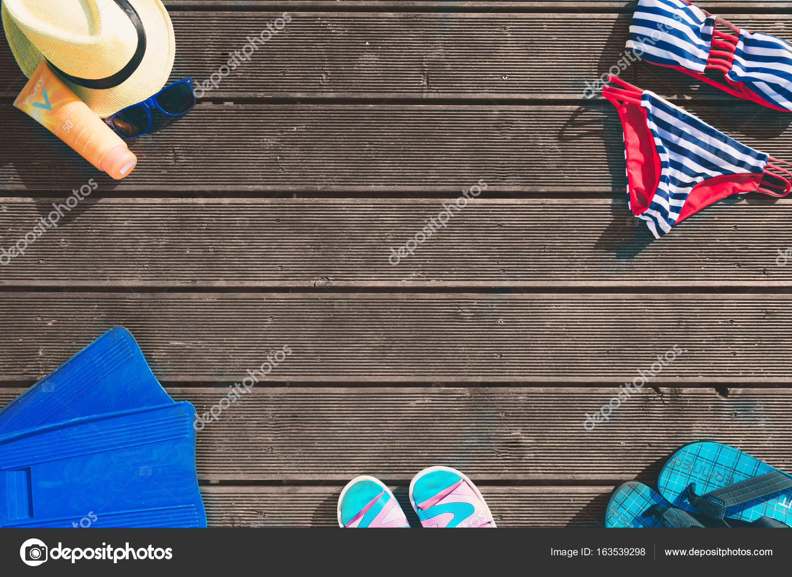372fc8bb44 Womens beachwear and accessories on wooden background. Beach clothing  concept. — Stock · Concept of luxury vacation. Cola on the pier.