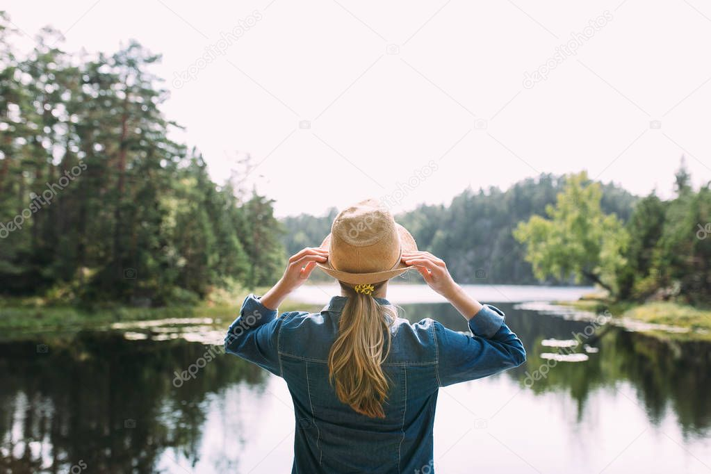 young woman near lake