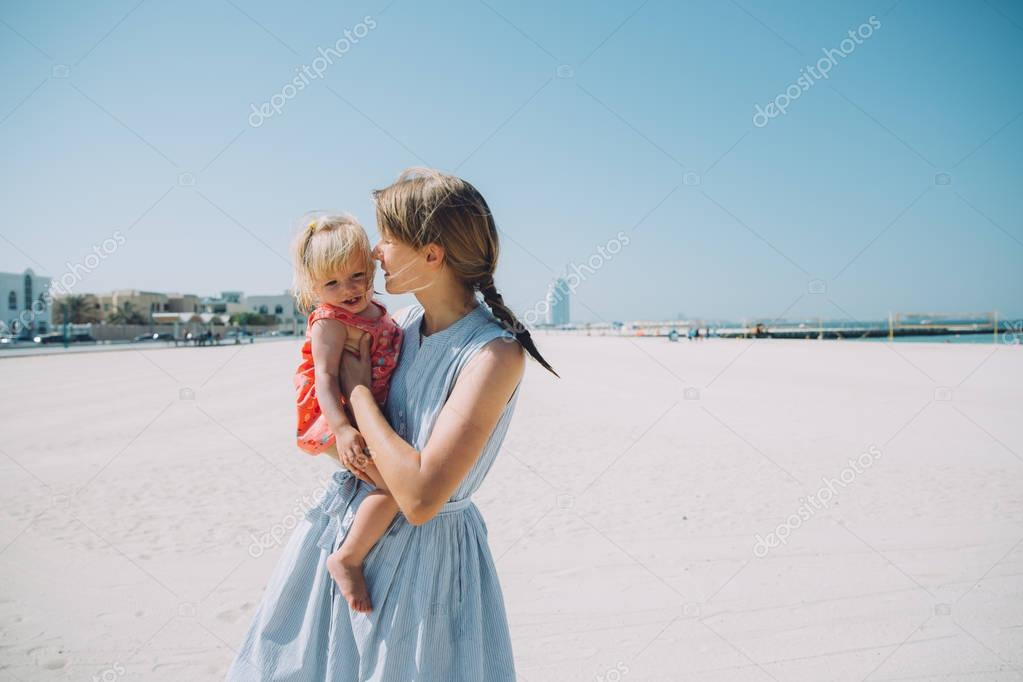 young mother and happy daughter